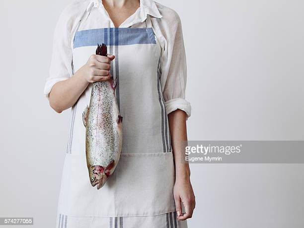 Young woman holding a fish