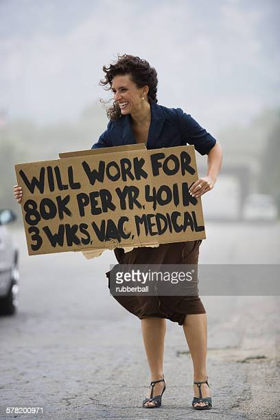 Young woman holding a help-needed sign