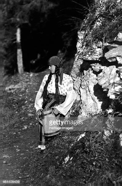 Young woman holding a jug Bistrita Valley Moldavia northeast Romania c1920c1945 Depicting customs and traditional labour in the rural Carpathian...
