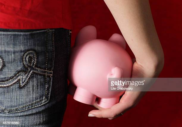 Young woman holding a piggy bank on January 19 in Bonn Germany