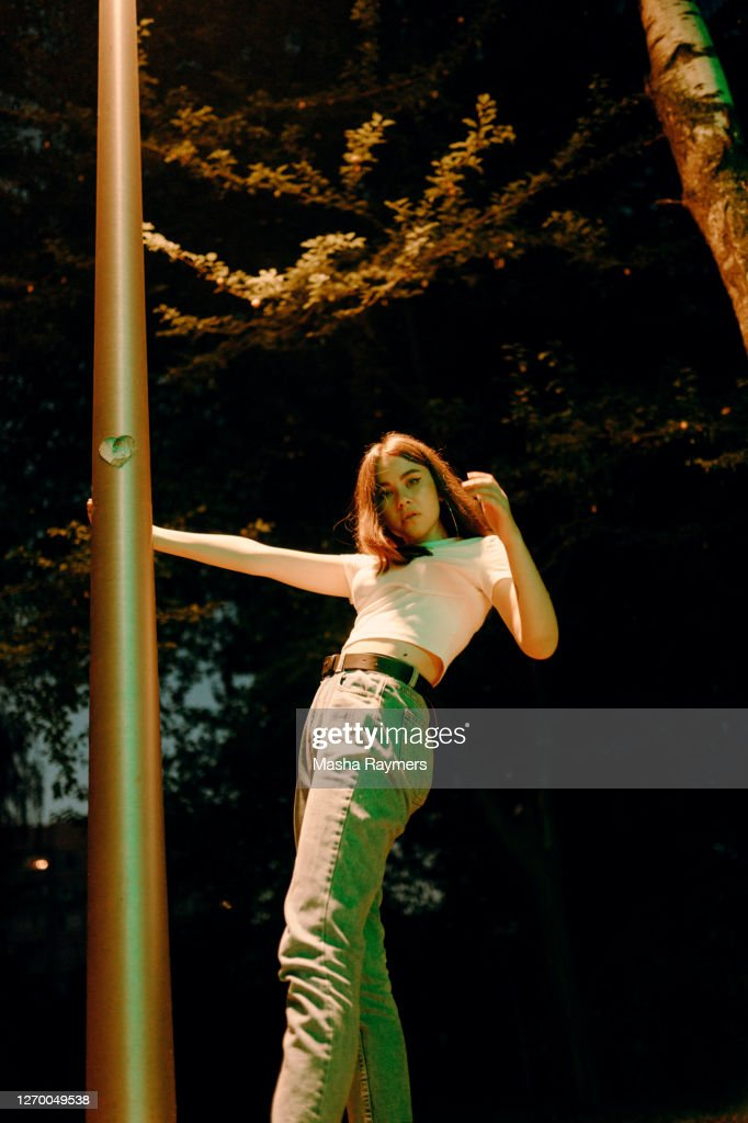 Young woman holding a pillar : Stock Photo