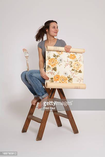 Young woman holding a retro wallpaper
