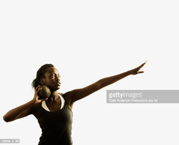 young woman holding a shot put ball - shot put stock pictures, royalty-free photos & images