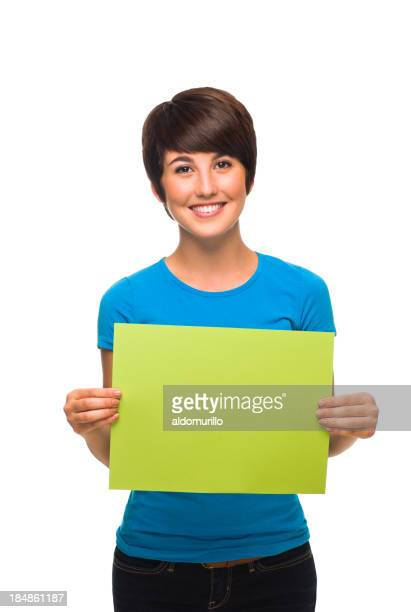 Young woman holding a small blank sign