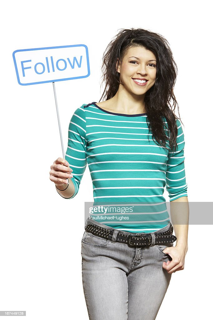 Young woman holding a social media sign smiling : Stock Photo