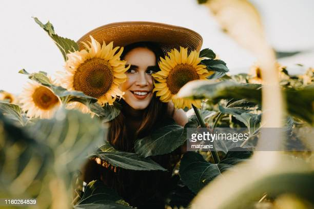 Young woman holding a sunflower