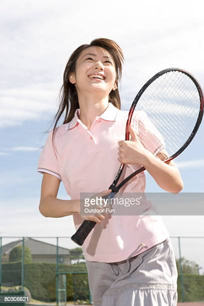 Young woman holding a tennis racquet