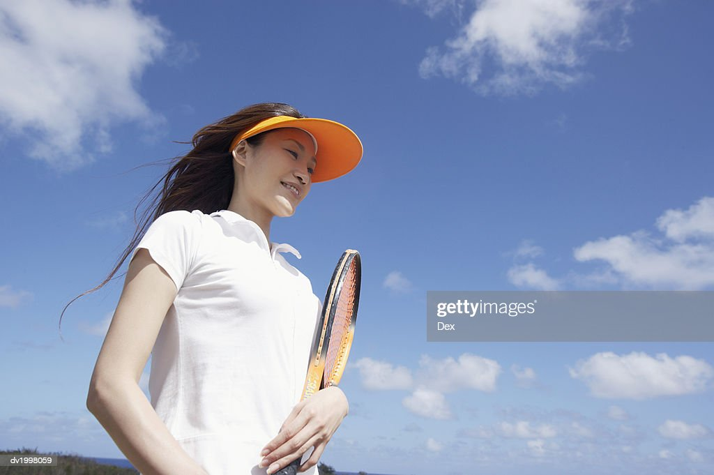 Young Woman Holding a Tennis Racquet : Stock Photo
