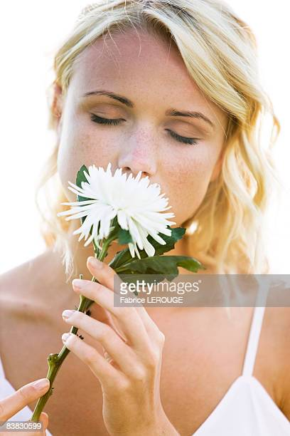 Young woman holding a white flower