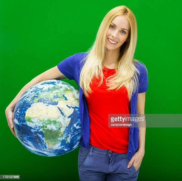 Young woman holding a world globe