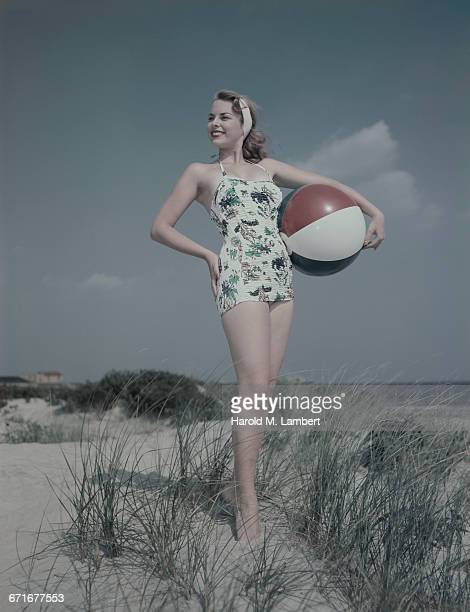 Young Woman Holding Beach Ball Wearing Swimsuit