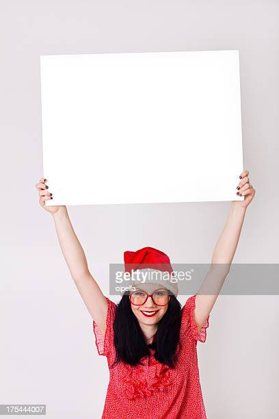 young woman holding blank board - christmas banner stock photos and pictures