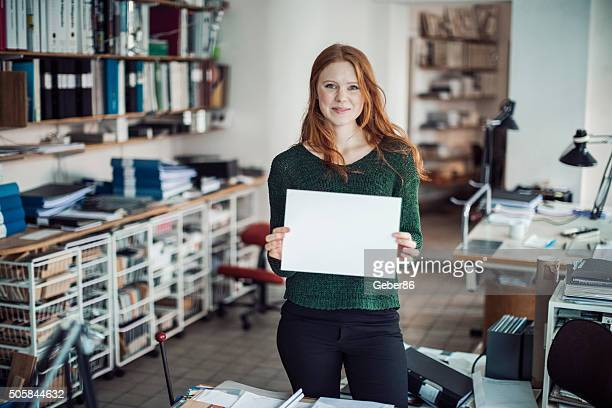 Young woman  holding blank board