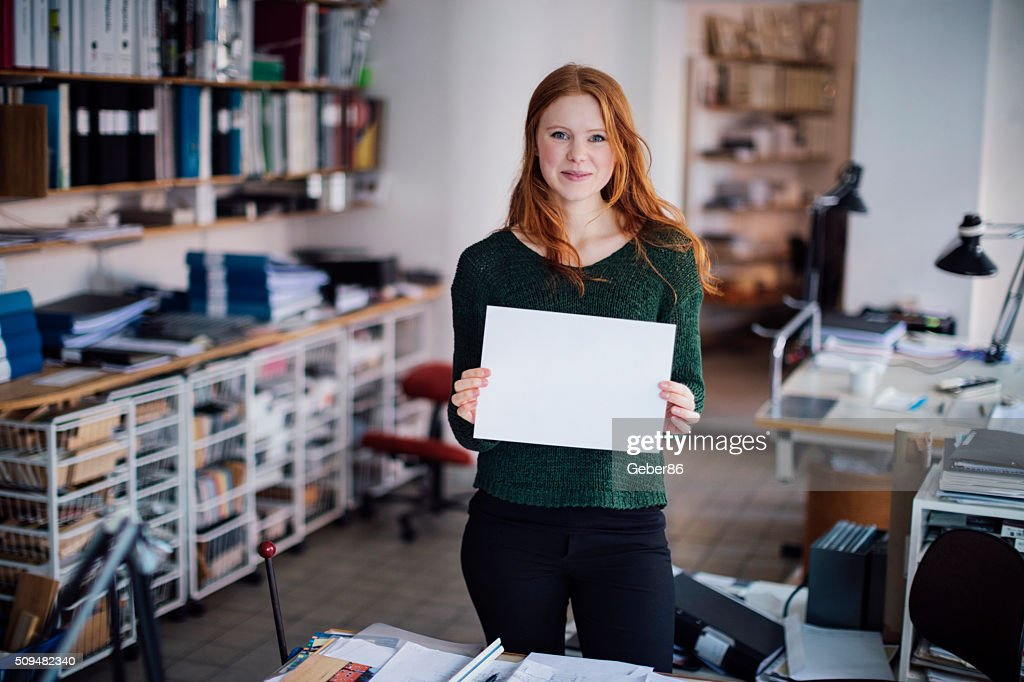 Young woman  holding blank board : Stock Photo