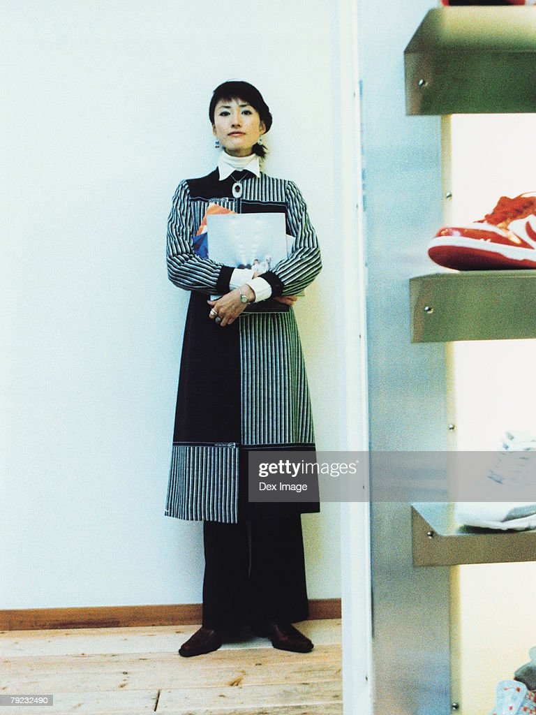 Young woman holding books : Stock Photo