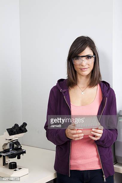 Young woman holding box of medical samples