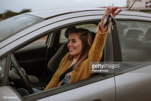 young woman holding car keys inside a car - new stock pictures, royalty-free photos & images