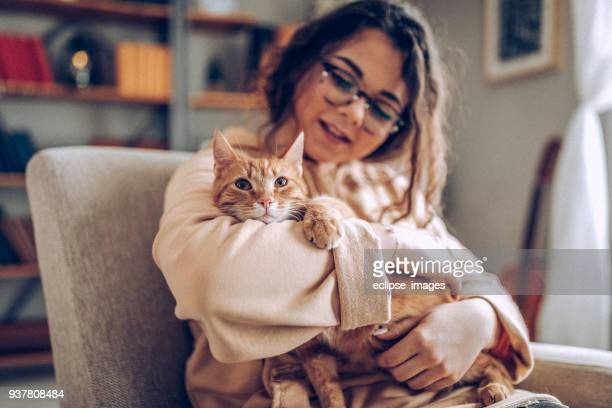 young woman holding cat - feline stock pictures, royalty-free photos & images