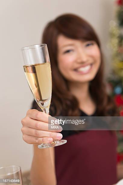 Young Woman Holding Champagne Flute