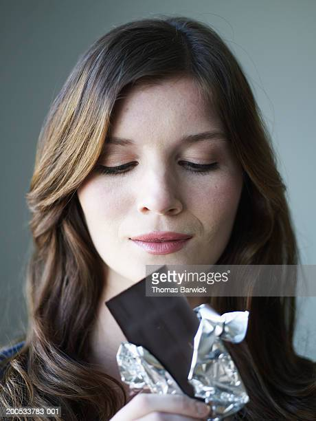 Young woman holding chocolate bar