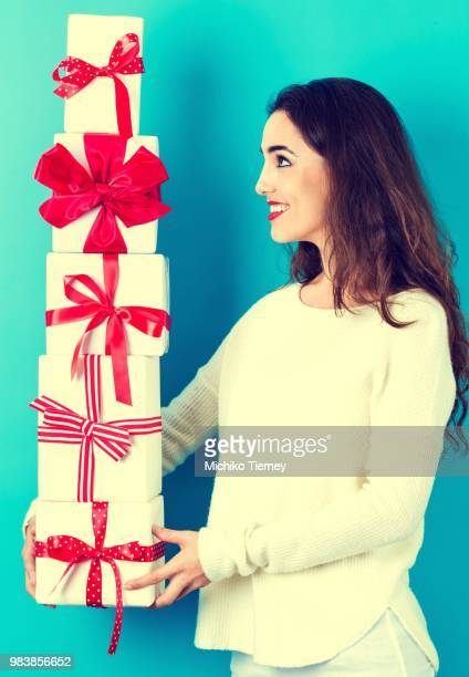 Young woman holding Christmas gifts