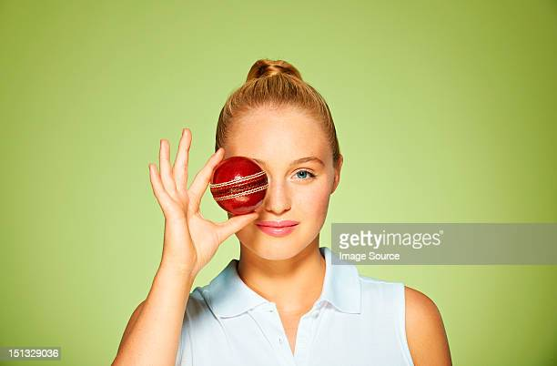 young woman holding cricket ball over her eye - women cricket stock pictures, royalty-free photos & images