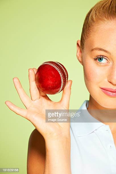 young woman holding cricket ball - cricket player stock pictures, royalty-free photos & images