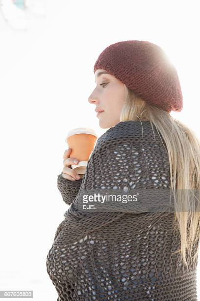 young woman holding cup of coffee on cold day - shawl stock pictures, royalty-free photos & images