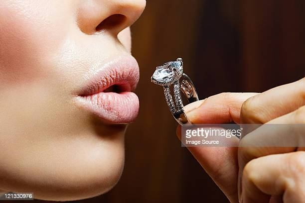 young woman holding engagement ring - millionnaire stock photos and pictures
