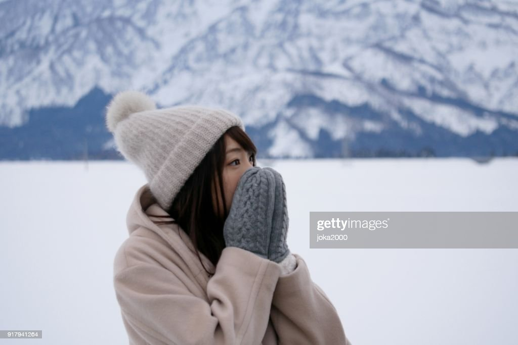 Young Woman holding face with hands : Stock Photo