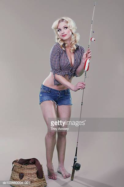 Young woman holding fishing rod
