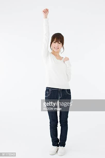 young woman holding fist in the air