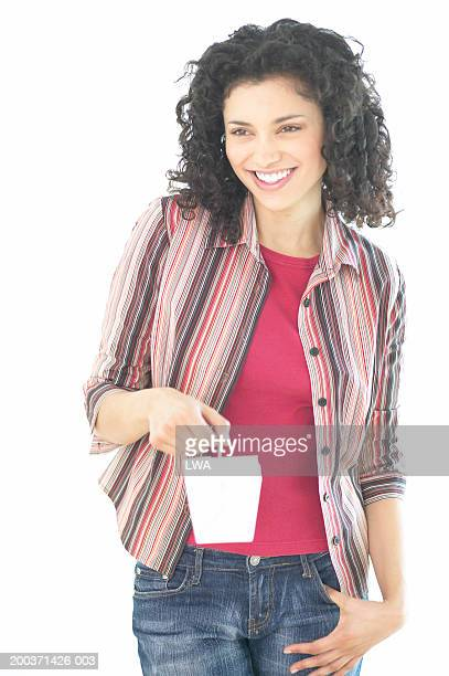 Young woman holding food container, smiling
