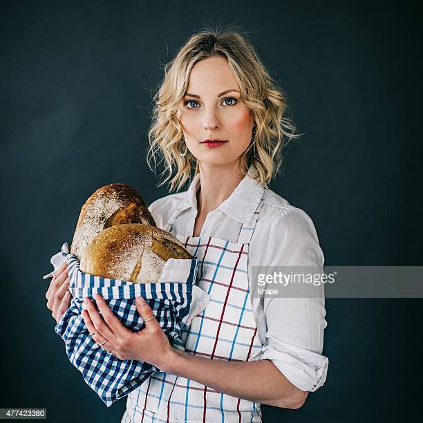 Young woman holding freshly made bread