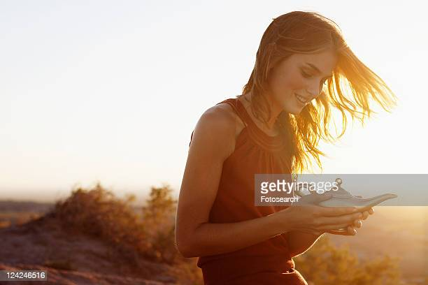 Young woman holding genie lamp