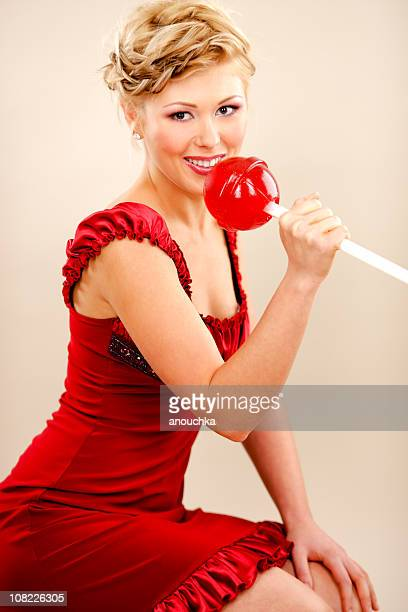 young woman holding giant red lollipop - 2000 2009 stock pictures, royalty-free photos & images