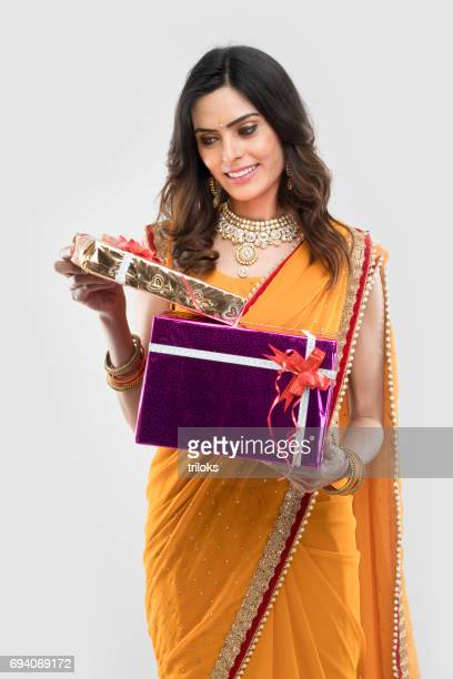 young woman holding gift boxes - sari stock pictures, royalty-free photos & images