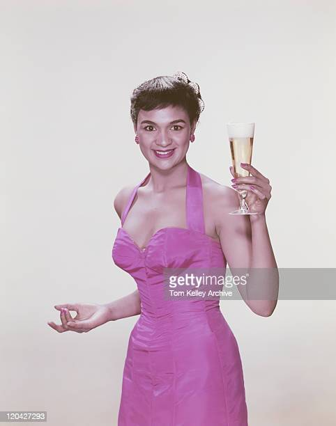 young woman holding glass of beer, smiling, portrait - 1956 stock-fotos und bilder