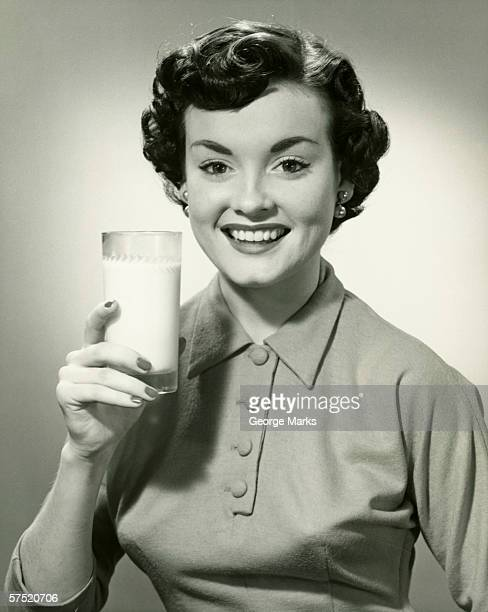 young woman holding glass of milk, (b&w), portrait - black and white food stock pictures, royalty-free photos & images
