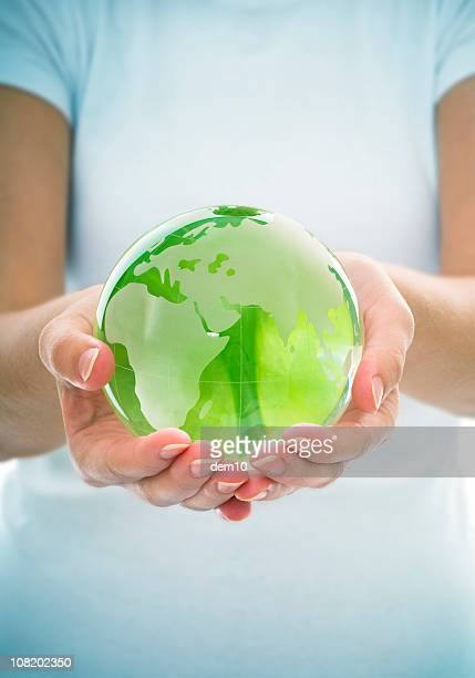 Young Woman Holding Green Transparent Globe