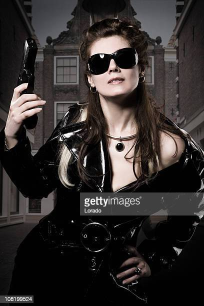 Young Woman Holding Gun
