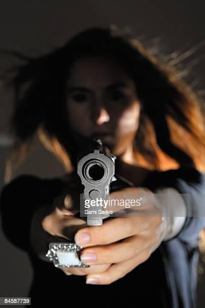Young woman holding gun