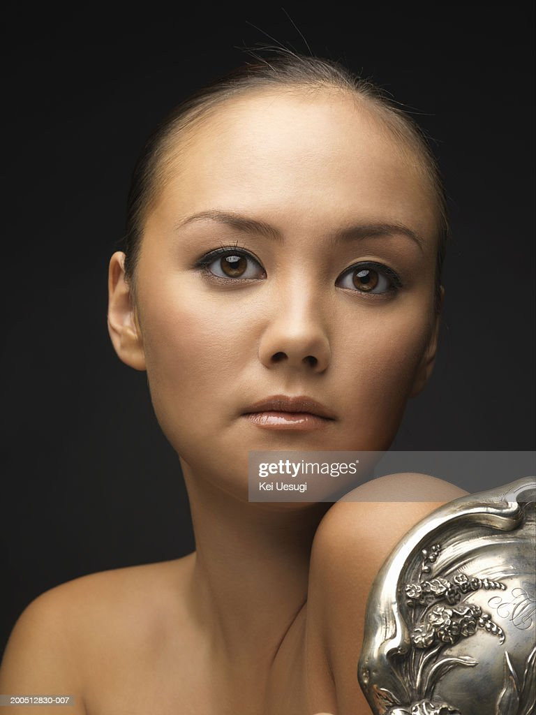 woman holding hand mirror. Young Woman Holding Hand Mirror, Portrait : Stock Photo Mirror