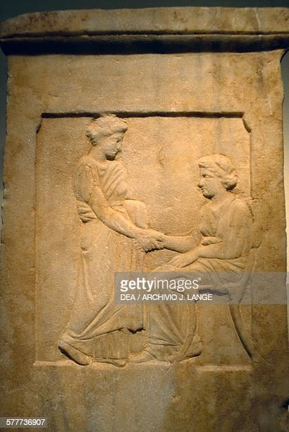 A young woman holding hands with a seated elderly woman funerary stele Greece Greek civilisation 4th century BC Athens Moussío Kikladikís Téhnis