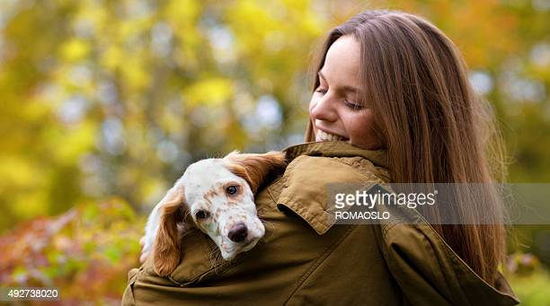 Young woman holding her English Setter puppy,  Oslo Norway