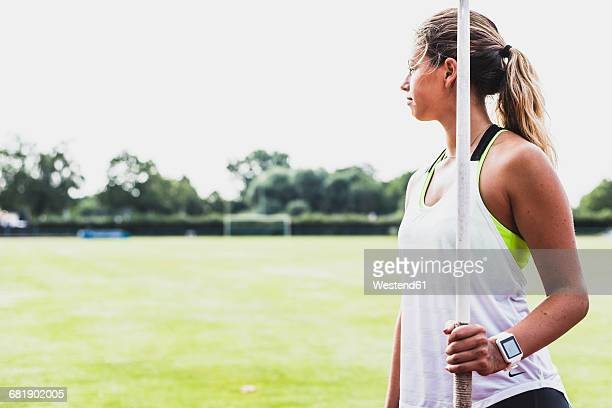 young woman holding javelin - women's field event stock pictures, royalty-free photos & images