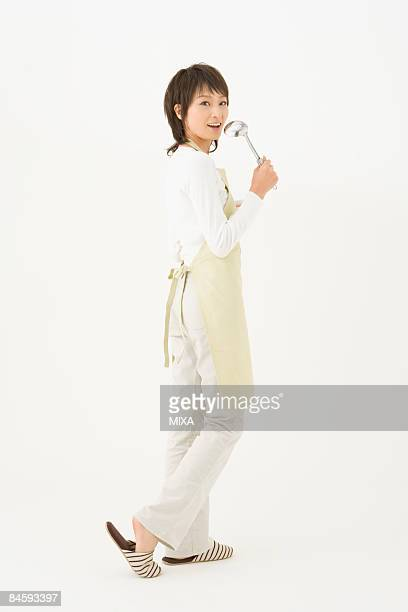Young woman holding ladle