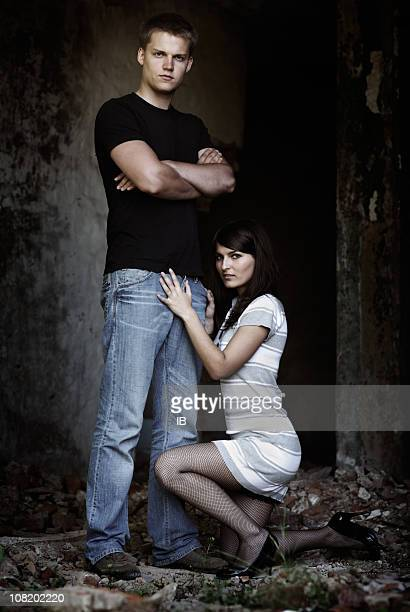 young woman holding man suggestively - women wearing pantyhose stock photos and pictures