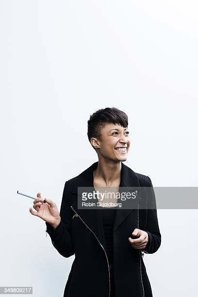young woman holding marker laughing - robin skjoldborg stock pictures, royalty-free photos & images