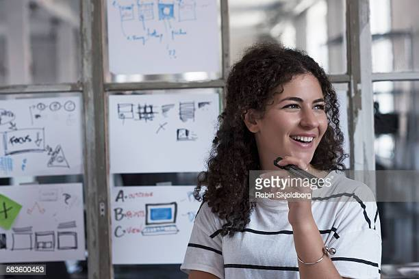 Young Woman holding marker pen smiling